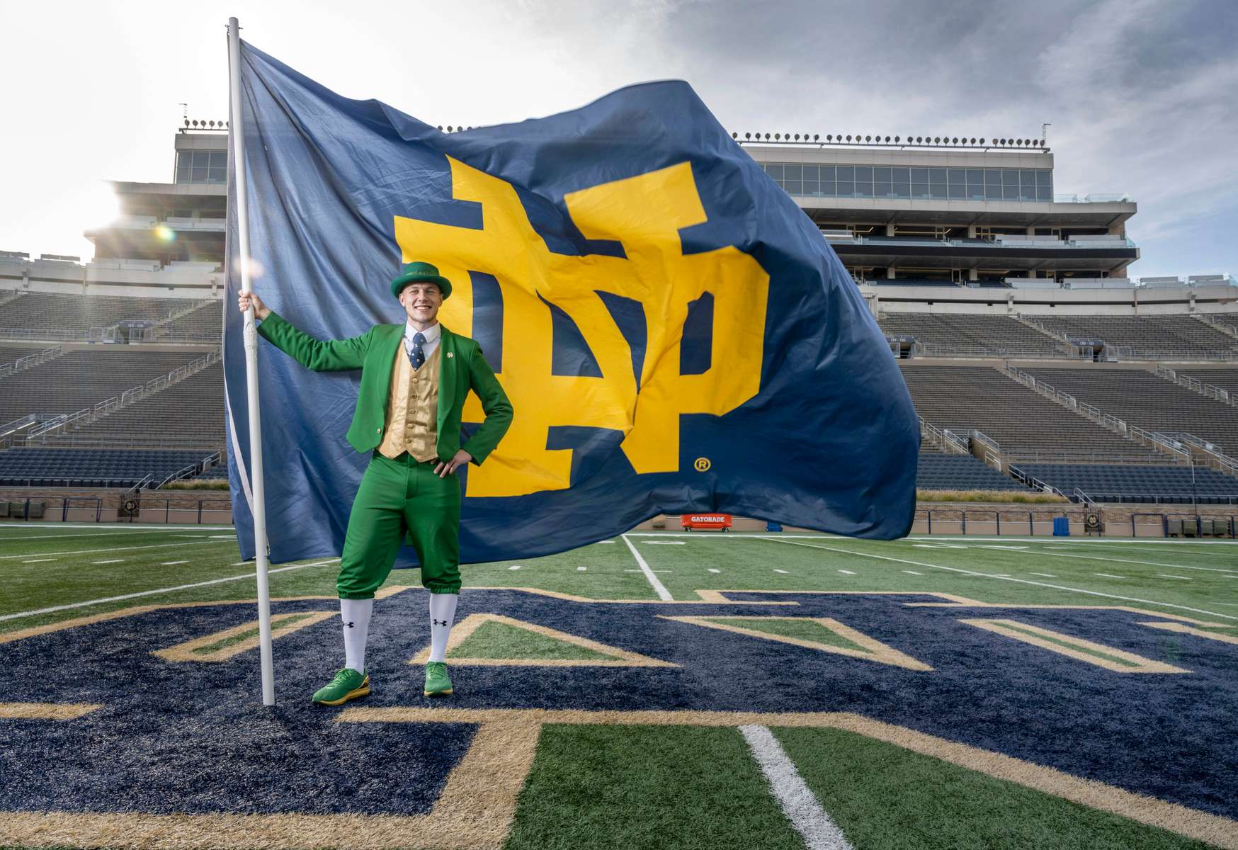 October 21, 2020; Conal Fagan the football Leprechaun with the ND flag in Notre Dame Stadium.  (Photo by Barbara Johnston/University of Notre Dame)
