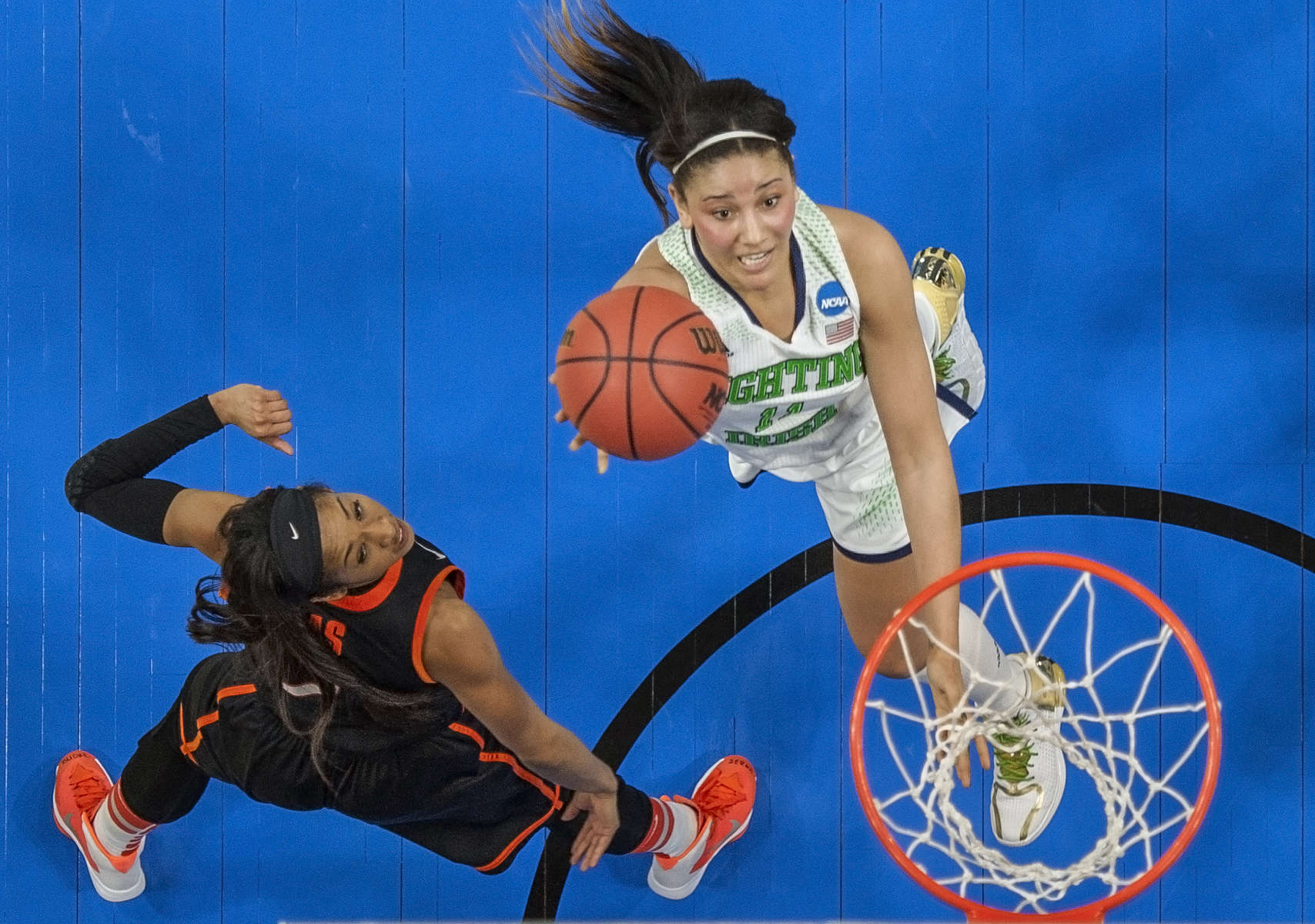 Notre Dame forward Natalie Achonwa shoots past Oklahoma guard Tiffany Bias during the regional semifinals at the Purcell Pavilion.
