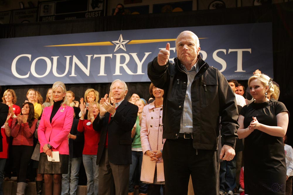 Republican presidential candidate John McCain gives thumbs up to supporters as he walks on stage during a rally at Strath Haven High School in Wallingford on November 2, 2008. Behind McCain (from the left) is his wife Cindy McCain, Senator Joe Lieberman and daughter Meghan McCain.