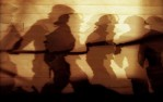 Volunteer firefighters' shadows merge while working closely together to put out a four-alarm barn fire in Douglas Township, Pennsylvania. Fifteen fire companies from the area were called to the scene which destroyed the building.