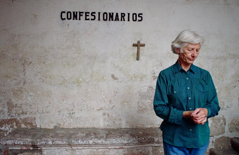 In Arequipa, Peru, Sister Patricia Gootee pauses at the confessional of the 400-year-old Convent of Santa Catalina.