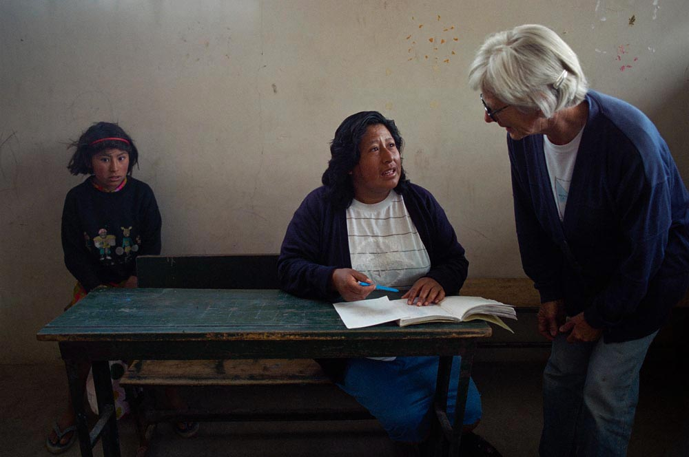 Norma Zuniga coordinator of the nutrition program in Arequipa, discusses with Sister Patricia the difficulty some families have in paying the modest fees at a community kitchen.