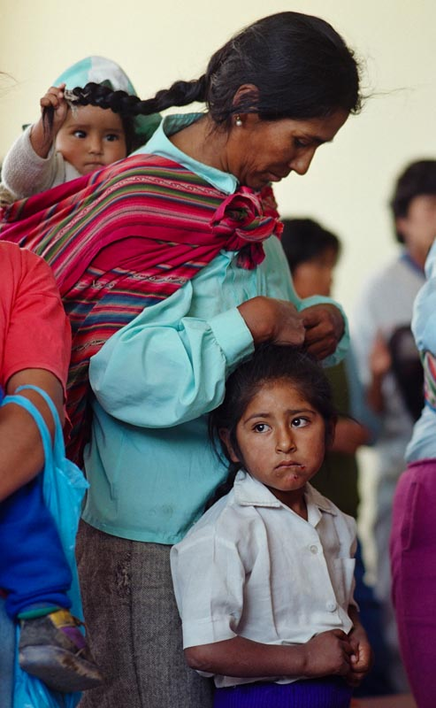 A women and her children attend a dedication service for a new communtiy center in Arequipa.