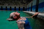 Sister Patricia relaxes in a pool built over a natural hot spring in Chivay.