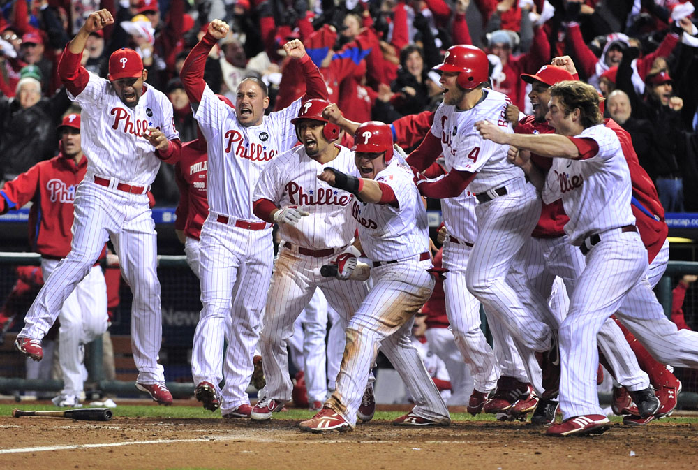 Philadelphia Phillies come out of the dugout to celebrate after shortstop Jimmy Rollins (not pictured) hit a walk off two-run double to defeat the Los Angeles Dodgers 5-4 in game four of the 2009 NLCS at Citizens Bank Park.