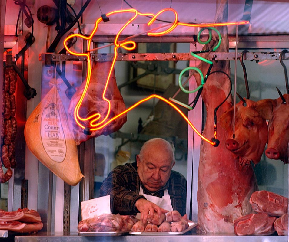 At Cappuccio's Meats in the Italian Market, owner Harry Crimi, 79, puts fresh wares in the window on February 20, 2005 in South Philadelphia. Crimi's in-laws established the shop in 1920.