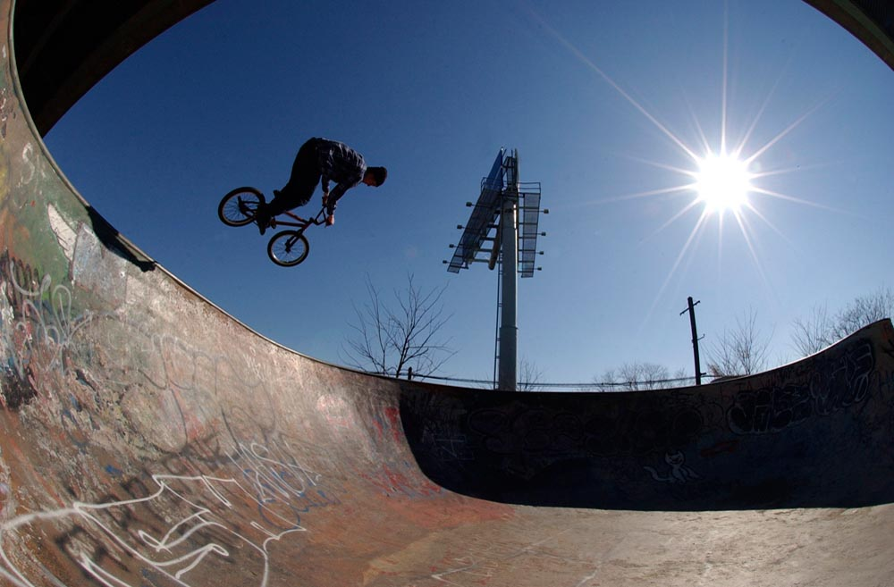 "Mick Kalata, 20, of South Philadelphia, does a ""quarter pipe air"" jump on his BMX bike in the 3-bowl area of FDR Skatepark. The skatepark is located beneath Interstate 95 in FDR Park and was built by skateboarders in the early 90's after the city banned them from skateboarding at Love Park."