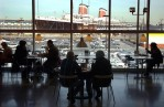 Customers take in the view of the SS United States and Ikea's parking lot at the furniture store's cafe on February 2, 2005.