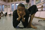 Kareem Goodwin, 16, of S. Philadelphia, stretches before a modern dance class at Point Breeze Performing Arts Center.
