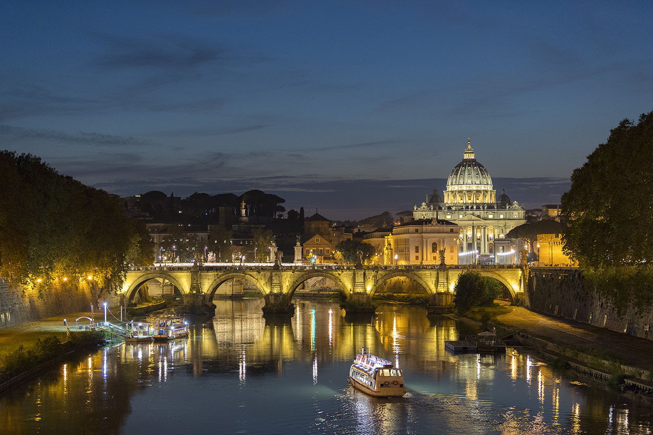 October 12, 2018; St. Peter's Basilica in the Vatican City, Saint Angelo Bridge and Tiber River at sunset, Rome, Italy. (Photo by Barbara Johnston/University of Notre Dame)