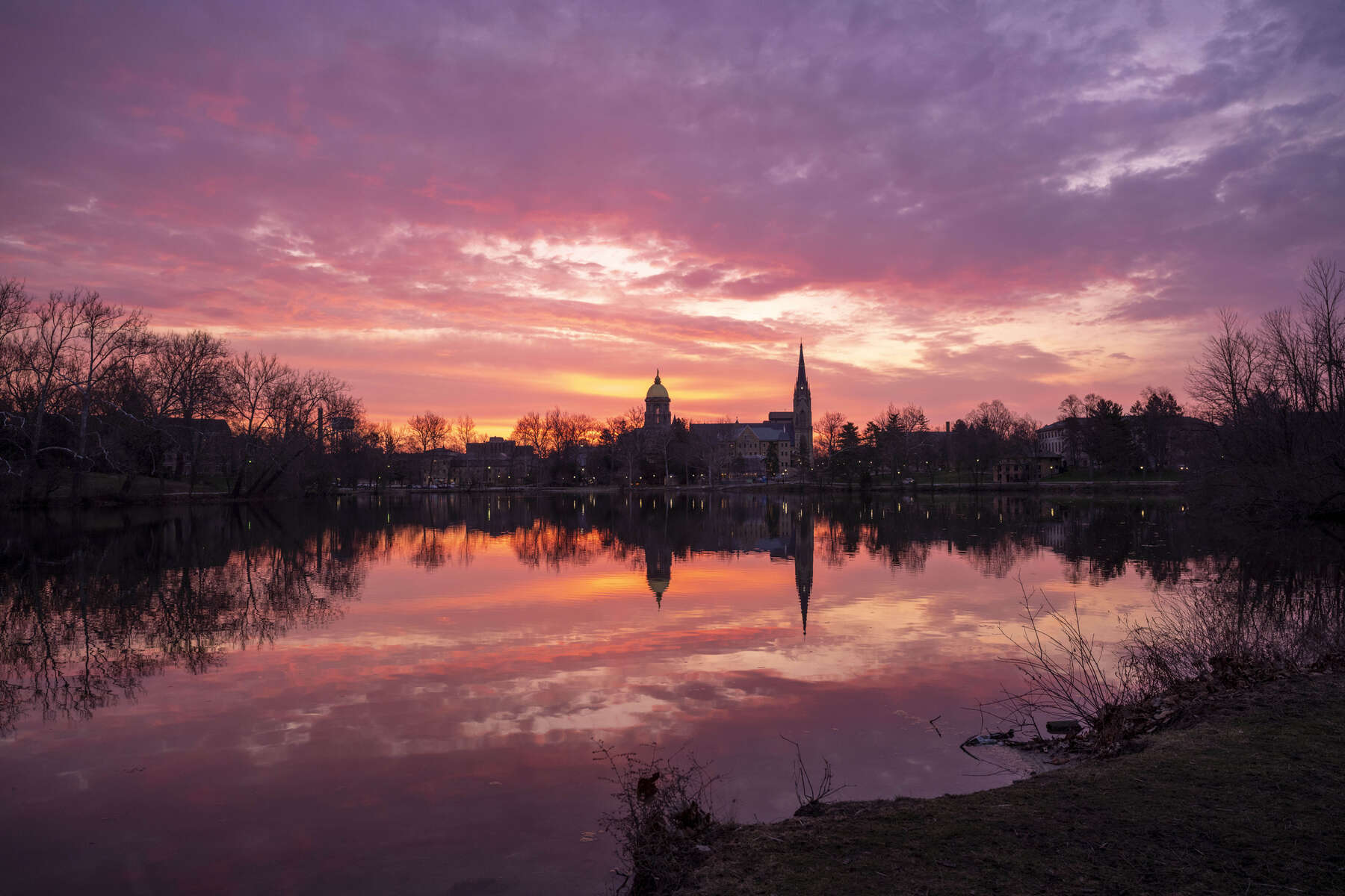April 3, 2020; Sunrise over St. Mary's Lake with campus in the background. (Photo by Barbara Johnston/University of Notre Dame)
