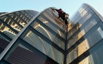 Tony Zurzolo, 20, works his way down inside an exterior valley of the Kimmel Center, November, 2001.