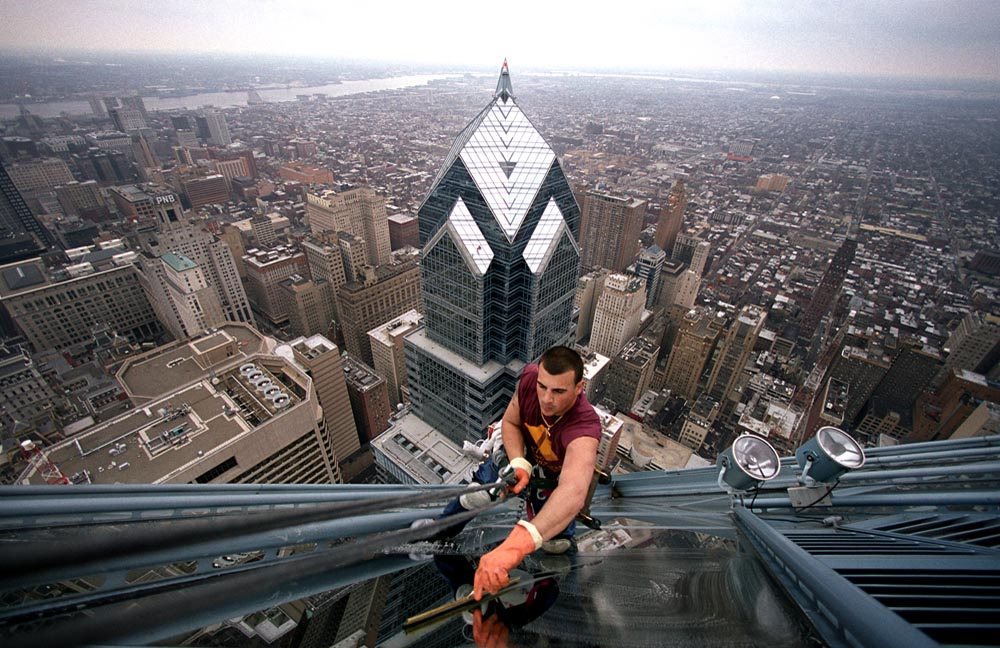 Anthony Zurzolo, 20, delivers a streak-free shine on the second highest peak of the city. Zurzolo is approximately 800 feet above the ground on the 61-story One Liberty Place on March 30, 2002. In the background is Two Liberty Place.