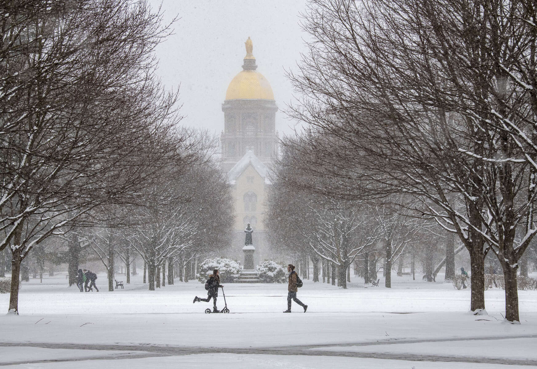 February 13, 2020; Students make their way across South Quad during a snowfall.  (Photo by Barbara Johnston/University of Notre Dame)