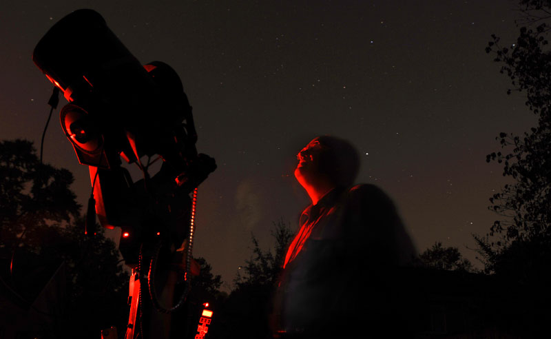 Astrophotographer  Michael Covington looks up at Comet Holmes outside of his Athens home on Thursday, November 1, 2007.