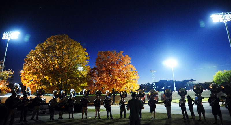 Sousaphones rehearse as the Georgia football team practices under the lights on Woodruff Field as the Georgia Redcoat Band practices on Wednesday, Nov., 5, 2008 in Athens, Ga.