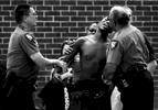 Athens-Clarke Police Major Mark Sizemore, left and Capt. Clarence Holeman, right, try to console the friend of 20-year-old Chateaubrian L. {quote}Toby{quote} Bailey who was shot to death in the 130 building of Bethel Midtown Village on Friday, August 27, 2010 in Athens, Ga.