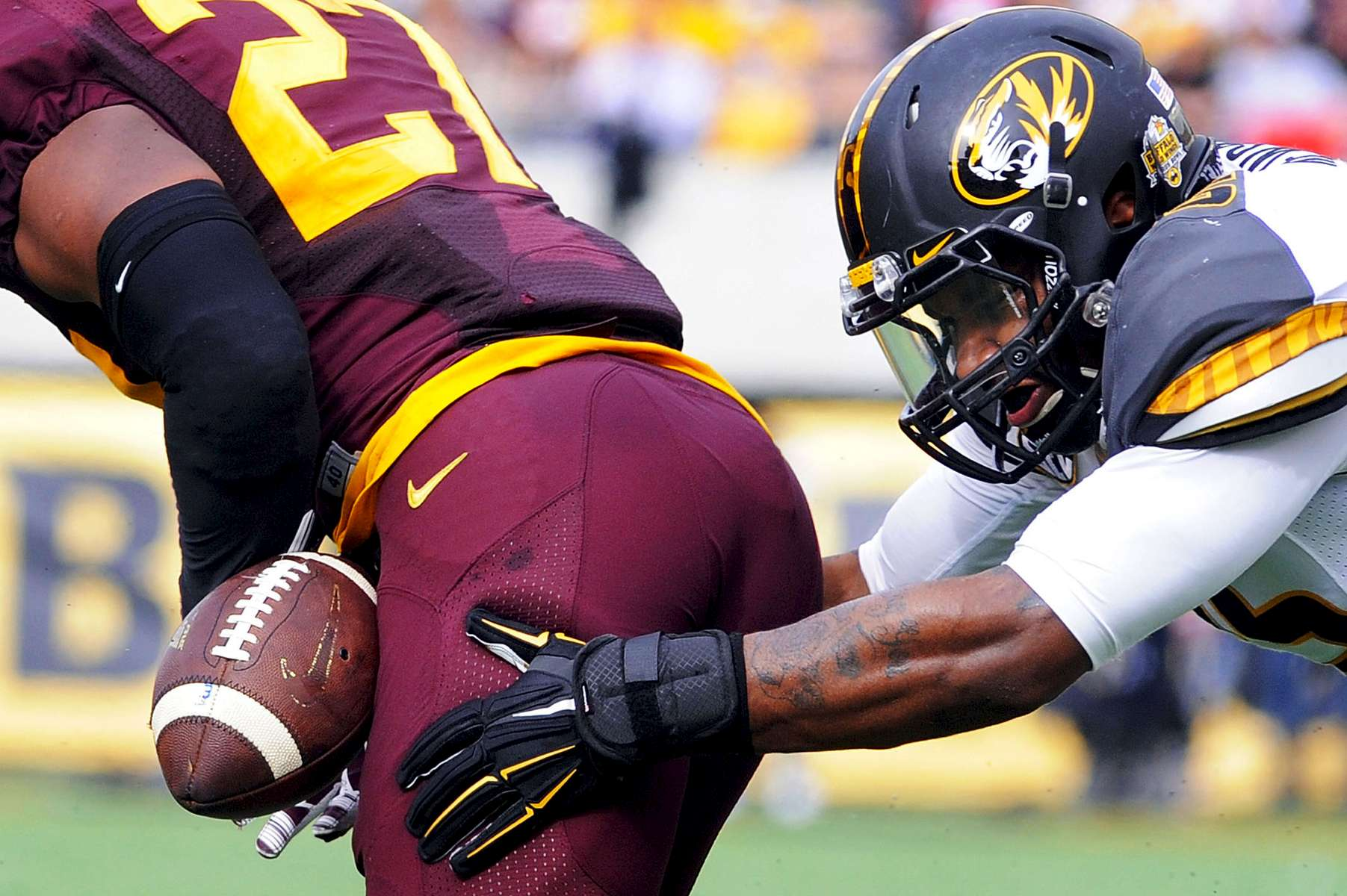Missouri Tigers linebacker Donavin Newsom (25) forces the ball loose from  Minnesota Golden Gophers running back David Cobb (27) as Missouri beats Minnesota 33-17 in the 2015 Citrus Bowl on Thursday, January 1, 2015 in Orlando, Fla.