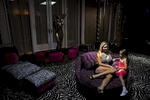 Jackie Siegel, wife of Westgate Resorts CEO David Siegel sits in the sitting room of her closet with her daughter Jordan, 5, at their home on Friday, July 27, 2012 in Windermere, Fla. The Siegels are the subject of the documentary film {quote}The Queen of Versailles{quote} that documents their life as they construct their 90,000 square-foot dream mansion in the middle of the real-estate crisis. Siegel filed a lawsuit against director Lauren Greenfield for defamation following the completion of the film.