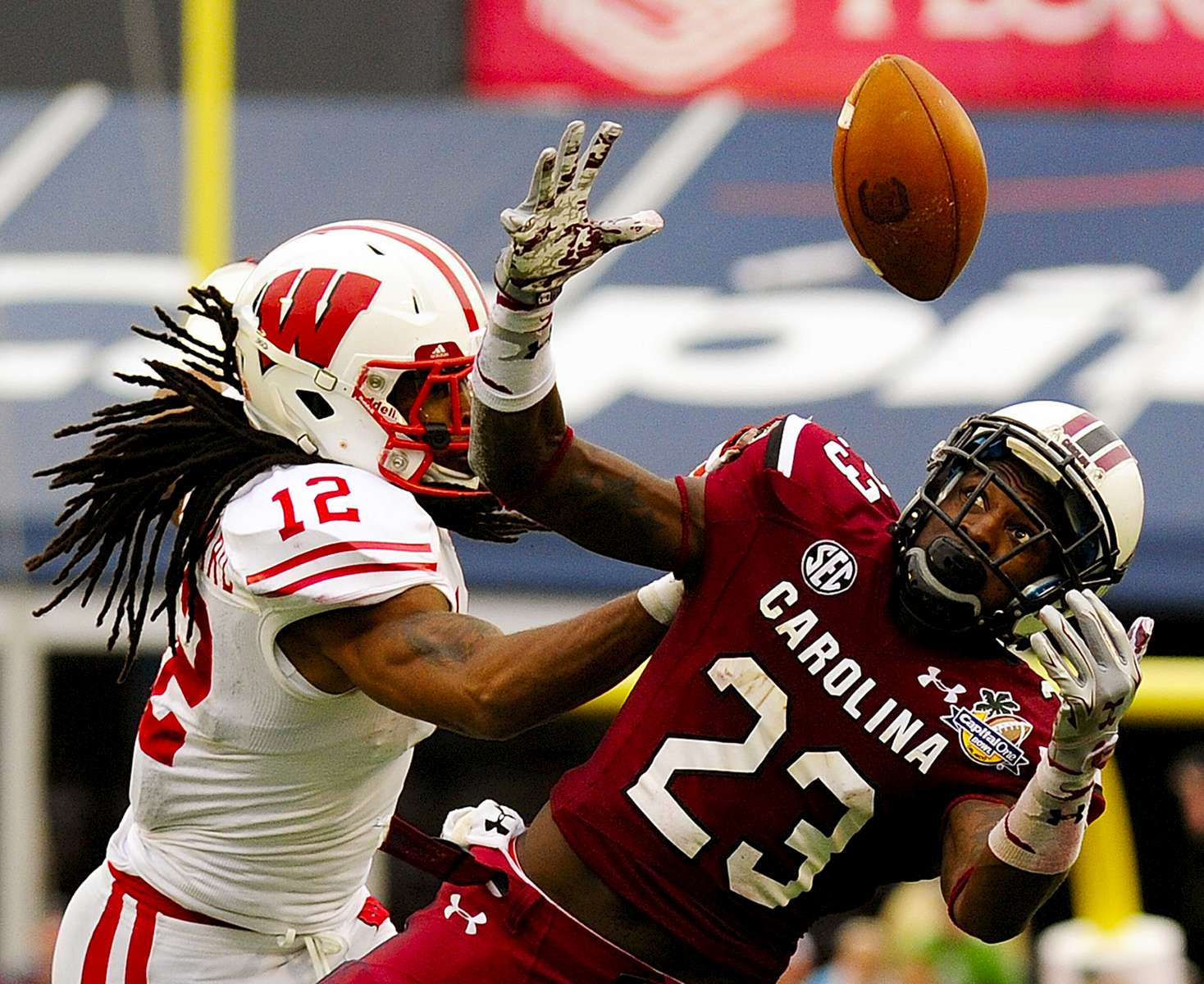South Carolina Gamecocks running back Bruce Ellington catches a 22-yard pass on fourth down in front of Wisconsin Badgers safety Dezmen Southward in the third quarter  as the Gamecocks beat the Badgers 34-24 in the Capital One Bowl at Florida Citrus Bowl on Wednesday, January 1, 2014.