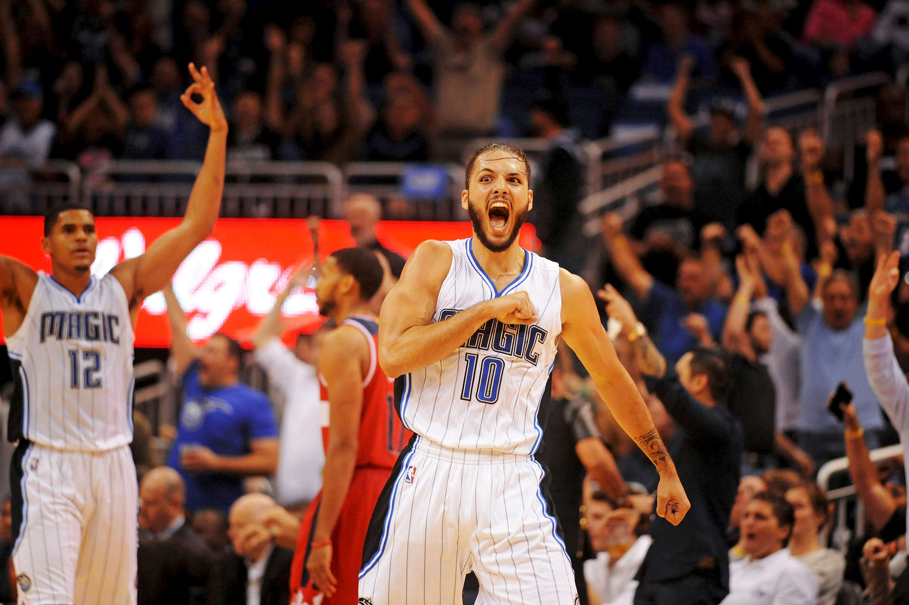 Orlando Magic guard Evan Fournier (10) celebrates after hitting a three-point shot to cut the Washington Wizards' lead to three points late in the fourth quarter as the Wizards beat the Magic 105-98 at Amway Center on Thursday October 30, 2014.