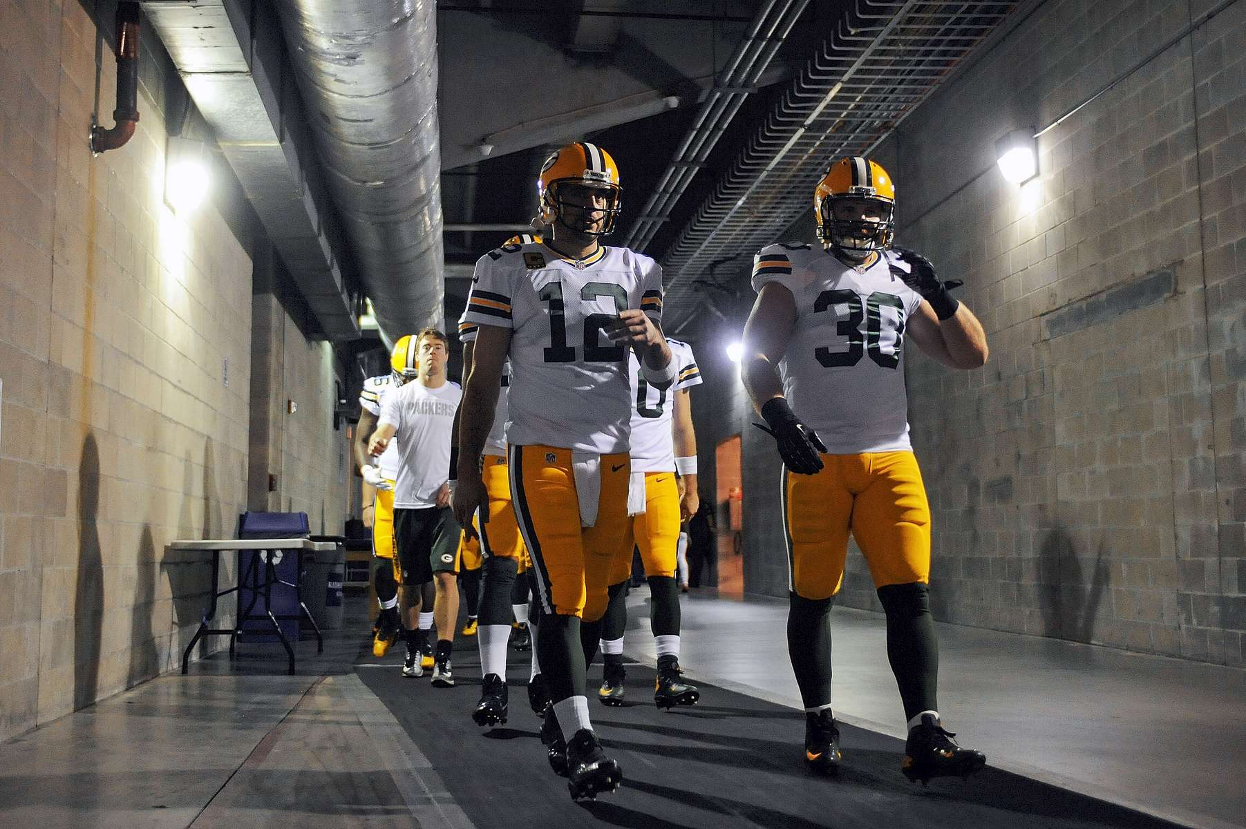 Green Bay Packers quarterback Aaron Rodgers (12) walks to the field before facing the Tampa Bay Buccaneers at Raymond James Stadium on Sunday, December 21, 2014 in Tampa, Fla.