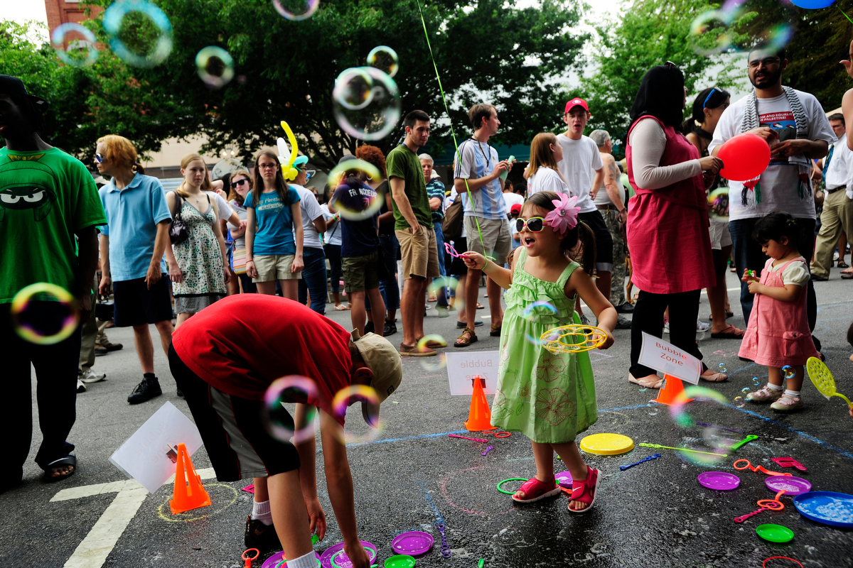 Children play with bubbles during the International Street Festival on Saturday, April 9, 2011 in Athens, Ga. The International Student Life association at the University of Georgia brought together more than 35 international and multicultural student organizations  together to present the cultural and educational displays.