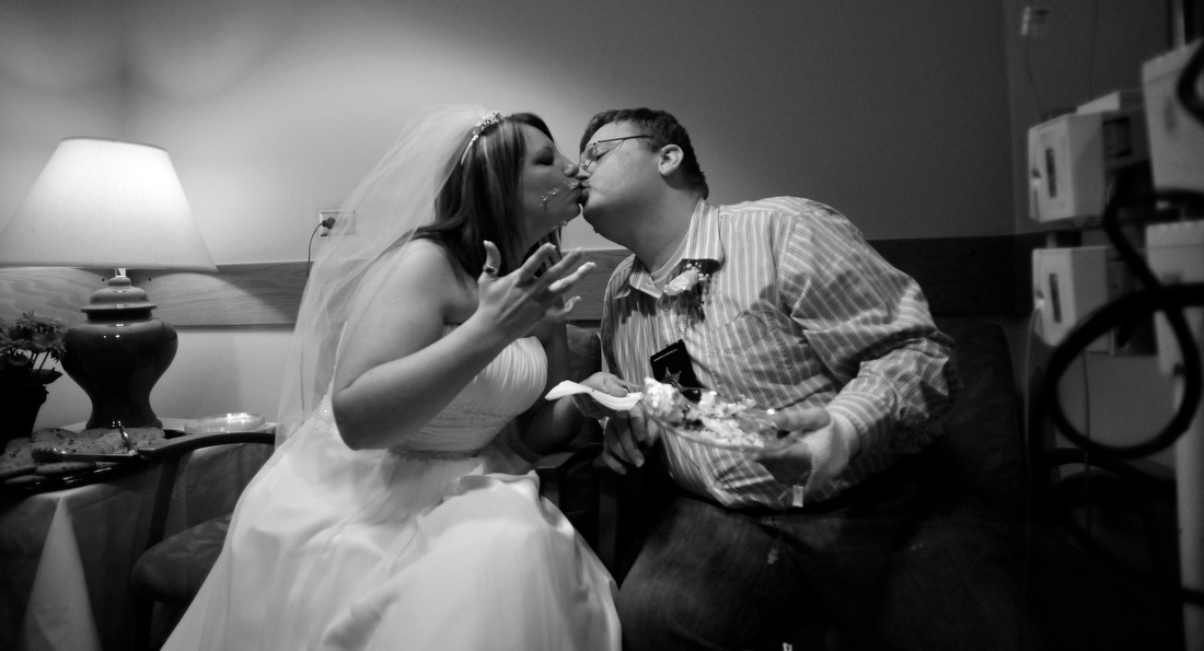 Barrow County Sheriff's Deputy Chris Hulett, right, kisses his bride Keni Carter during their wedding reception at Athens Regional Medical Center on Fri., Jan 29, 2010 in Athens, Ga.  Hulett was diagnosed with end-stage melanoma.  Carter decided Friday morning that they should be married later that day.