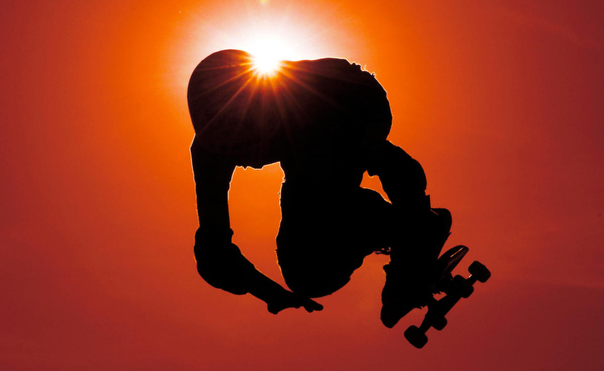 Eleven-year-old Kaden Campbell is silhouetted against the sun at the skate park in Southeast Clarke Park on Wednesday, March 31, 2010 in Athens, Ga.