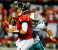 Atlanta Falcons quarterback John Parker Wilson, left, fumbles as he is hit by Miami Dolphins cornerback Jimmy Wilson in the first half of a preseason NFL football game, Friday, Aug. 12, 2011, in Atlanta. (AP Photo/David Manning)