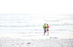 Tourists walk on the beach on Thursday, February 7, 2013 in Destin, Fla.