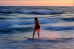 A skimboarder surfs on Friday, February 8, 2013 in Destin, Fla.
