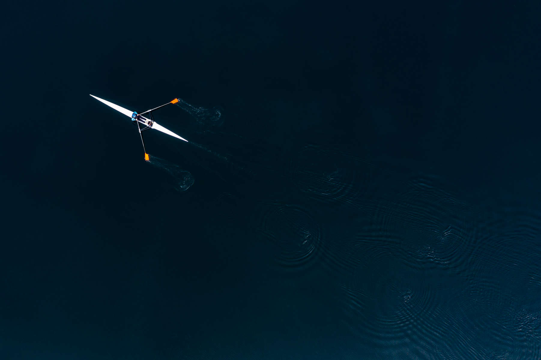 Eileen rowing her Maas Flyweight on a perfect morning on Pettit Lake in the Stanley Basin Idaho.