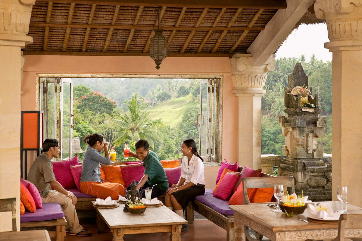 Local Balinese having a good time at the Indus Restaurant that is at the top of a ravine overlooking the Wos River. Designed by owners Ketut Suardana and Janet deNeefe. Photo by Jay Graham