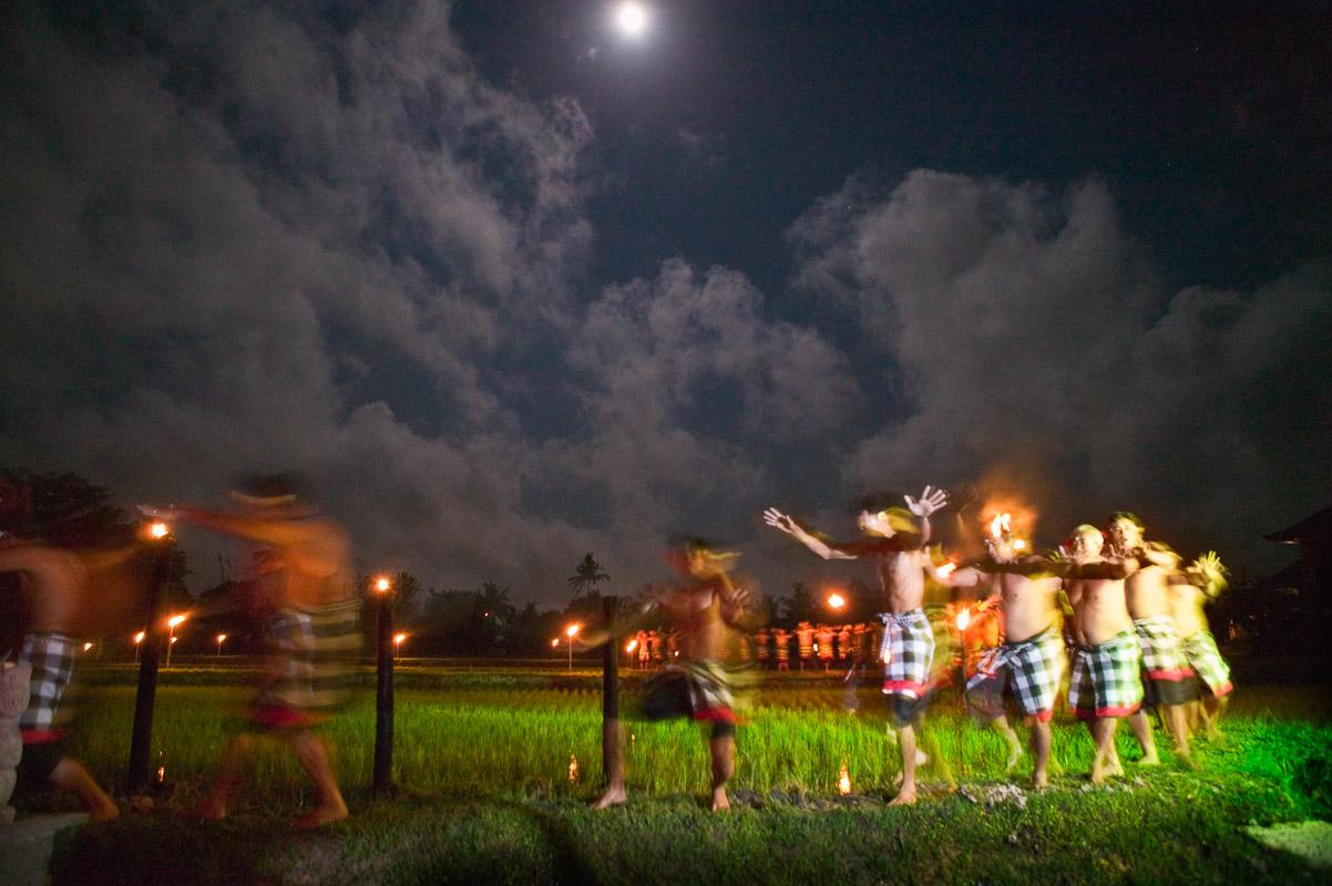 Men from the villages of Nyuh Kuning and Peliatan dance the Kecak dance under a full moon at Laka Leke owned by ibu Wayan and Ketut Krinting. Photo by Jay Graham