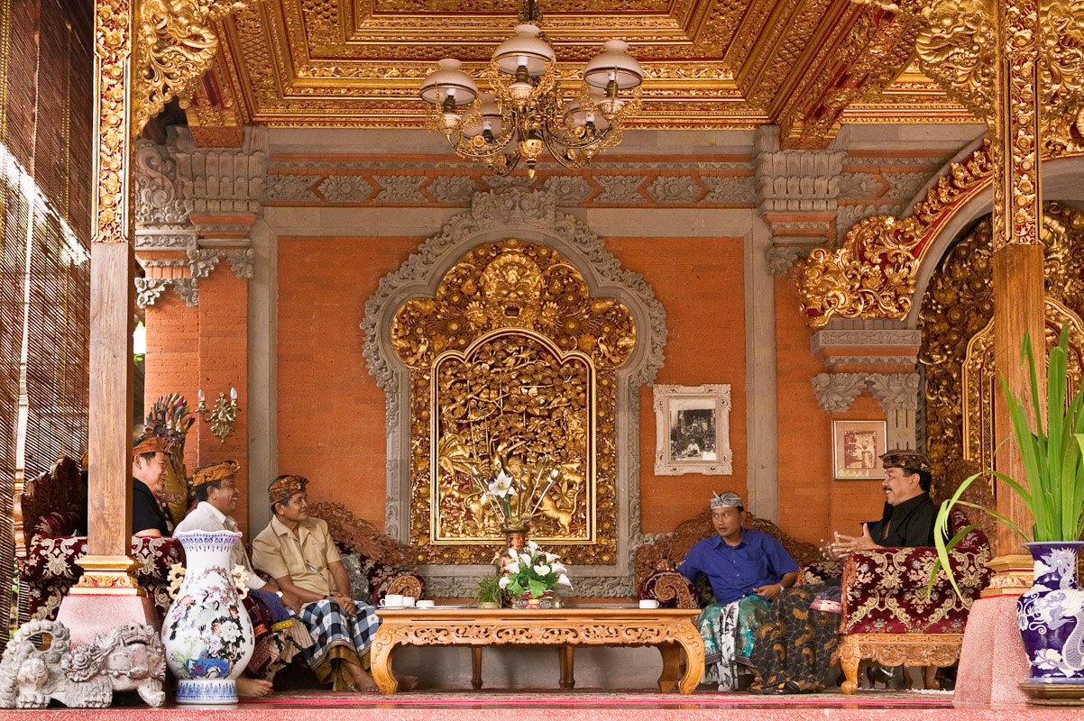 Puri Agung Ubud is home to the Royal Family of Ubud. Carved wood covered in gold-leaf combine with batu bali and carved batu paras makes an elegant setting for meetings and social events. Tjokorde Gede Putra Sukawati (extreme right) spends much time meeting with local community leaders, heads of state from foriegn countries and Indonesian officials. Photo by Jay Graham