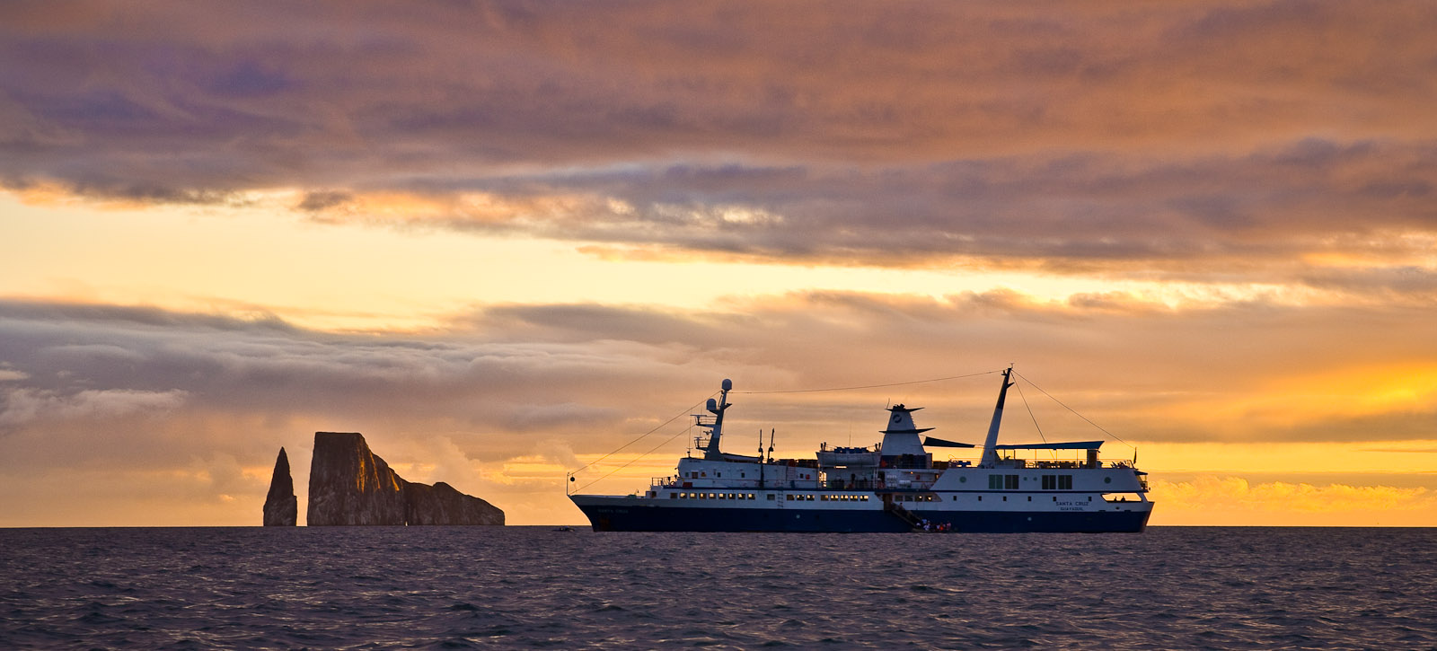 The good ship Santa Cruz anchored near Kicker Rock off San Cristobal Island. An adventure expedition organized by High Country Passage. Photo by Jay Graham