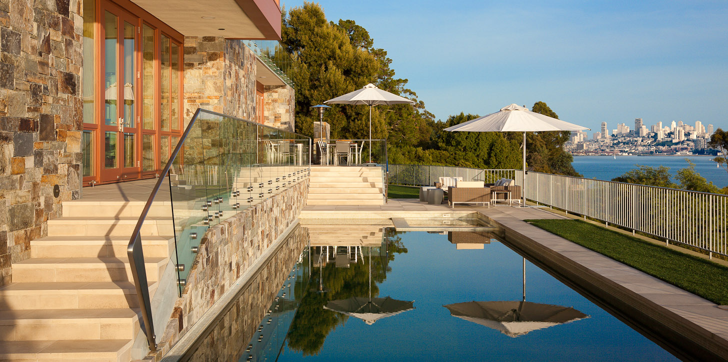 Swimming pool with view to San Francisco, CA. Residence designed by Sutton Suzuki Architects. Photo by Jay Graham