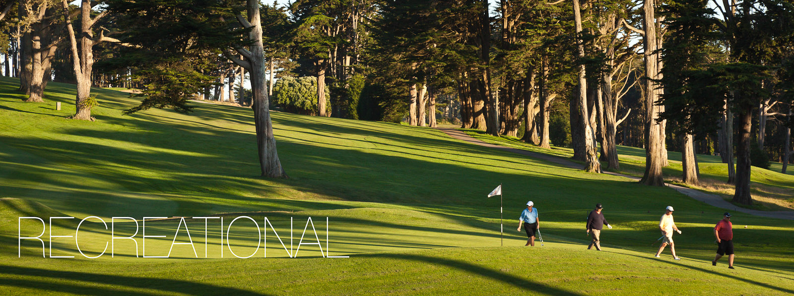 Golfers walking off the green in the late afternoon sun at the Presidio Golf Course, San Francisco, CA. Photo © 2011 Jay Graham, all rights reserved