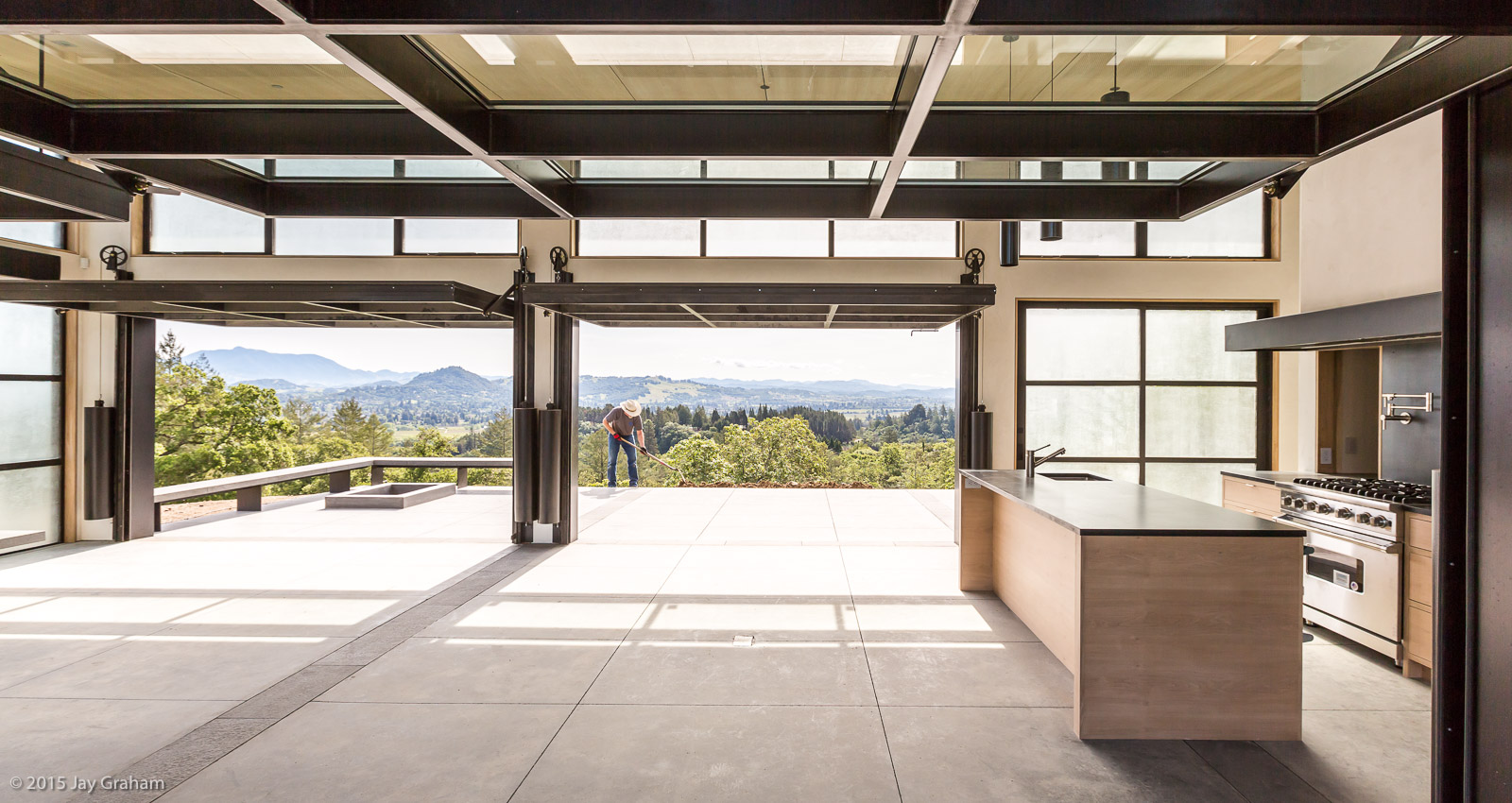 This is a dramatic residence with Renlita floating doors that allow a seamless transition between indoor and outdoor spaces. Designed by Feldman Architecture, built by Caletti Jungsten, with lanscaping by Arterra Landscape Architects.