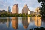 View of downtown Austin skyline with reflections in Town Lake. Photo by Jay Graham
