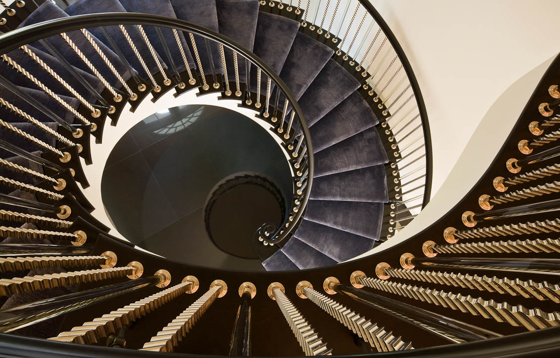 Private residence with a magnificent spiral staircase. Built by Larry Christiani Construction. Photo by Jay Gaham