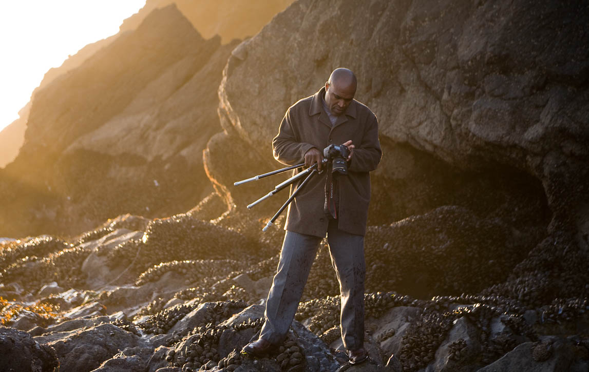I was at Rodeo Beach with friends on Christmas Day 2009 watching the surf and late afternoon sun. I got intrigued by this local photographer {quote}working{quote} the waves and low, warm light. Photo by Jay Graham