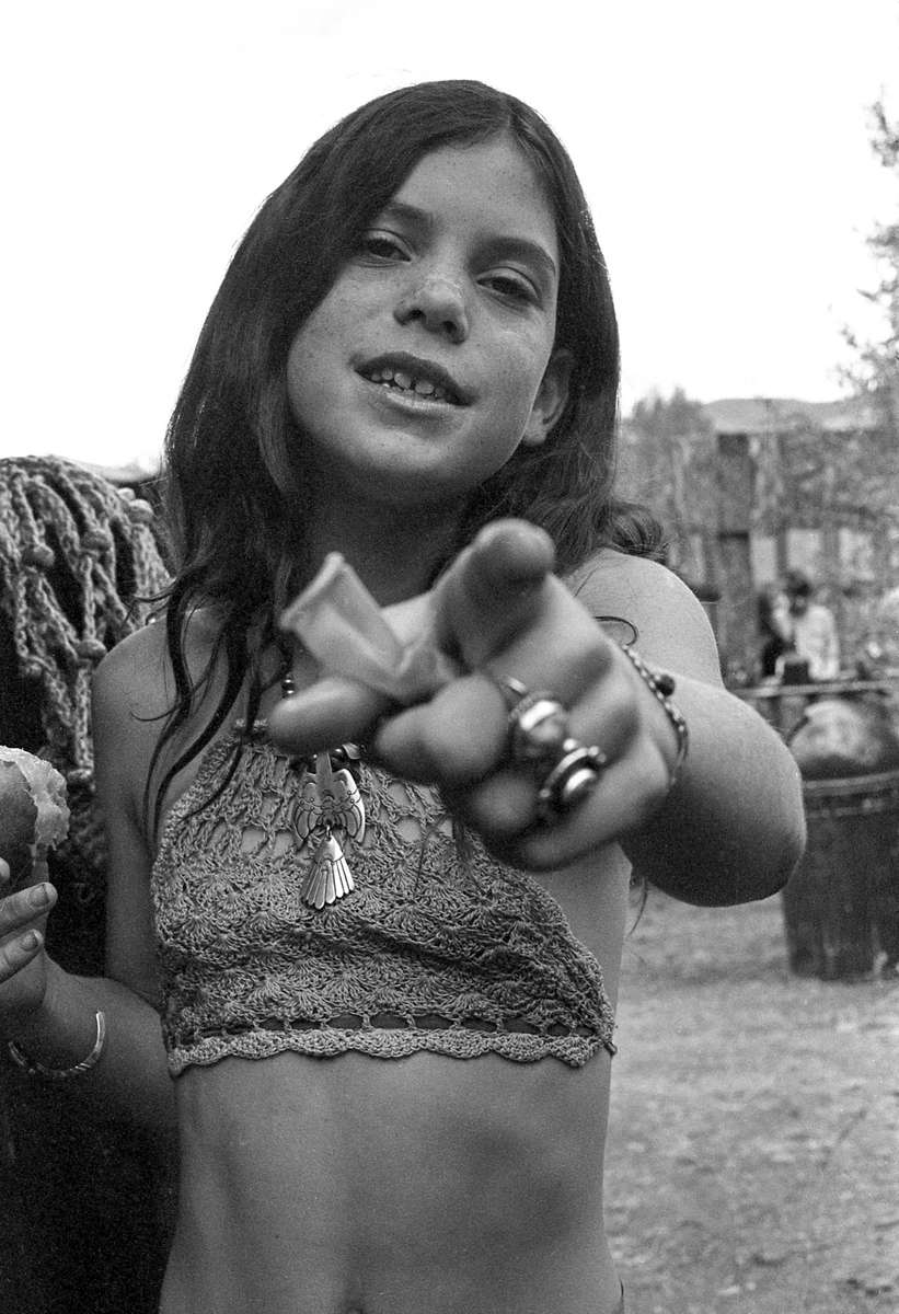 Young woman pointing, Aspen, CO