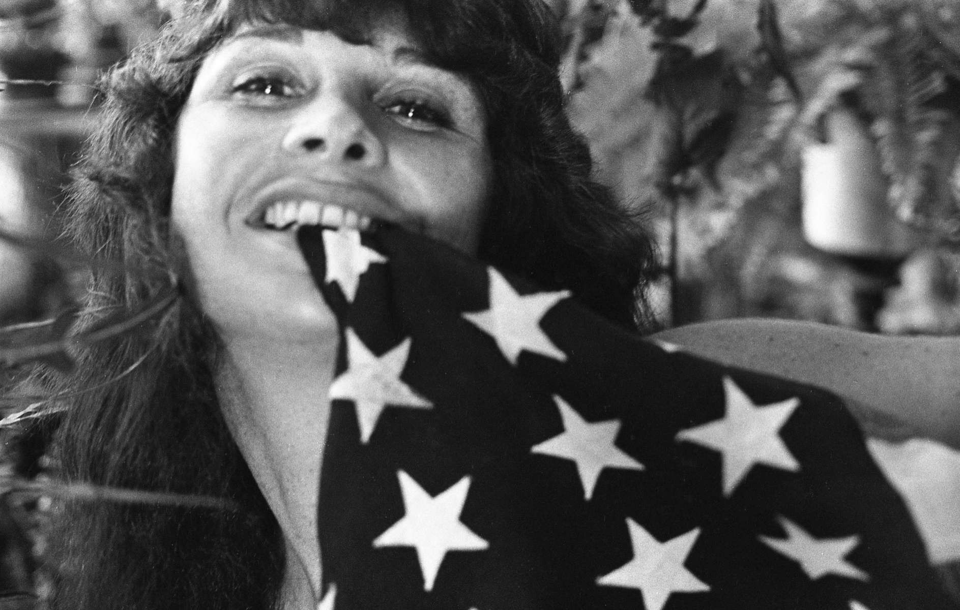 Woman Biting Flag, Aspen, CO