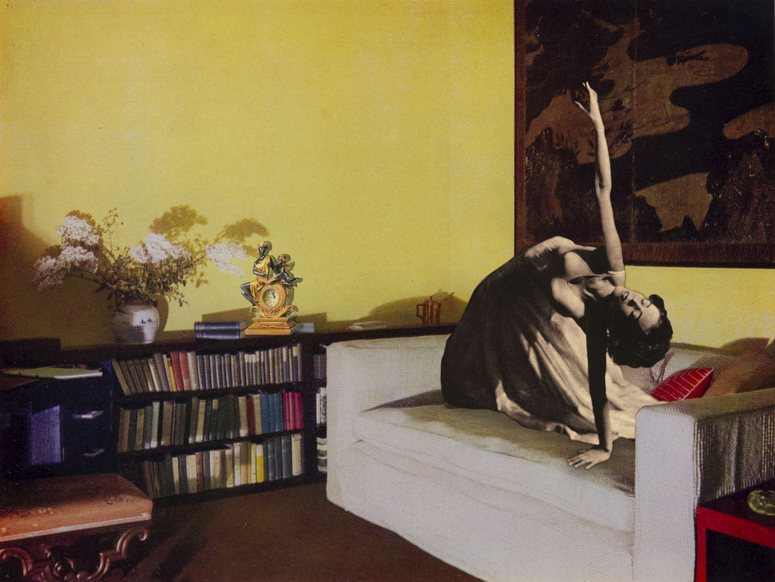 Mary Wigman poses on a larege settee in a room with Chinese yellow varnished walls. Behind Mary is an18th century Japanese screen in tones of gold and black. Design by Derek Patmore. (2018)