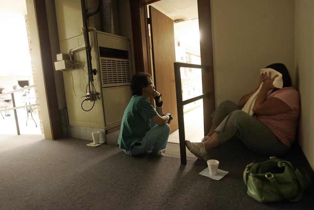 Hiromi Baldwin (left) looks upon TBI survivor Tammie Drake as she struggles with vertigo.