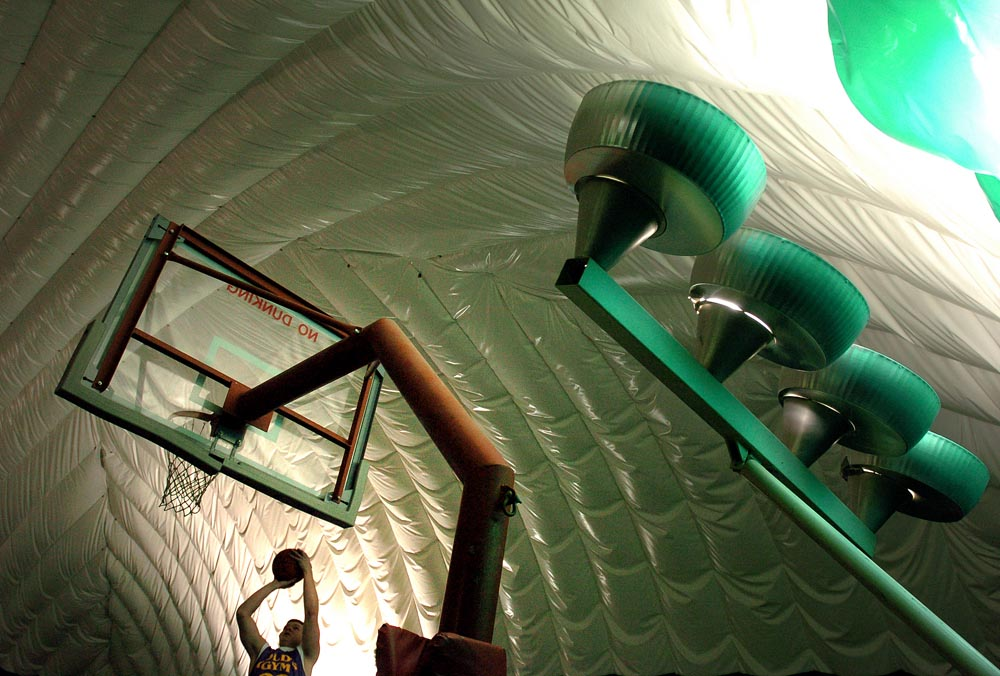Joe O'Connor plays basketball inside a bubble dome.