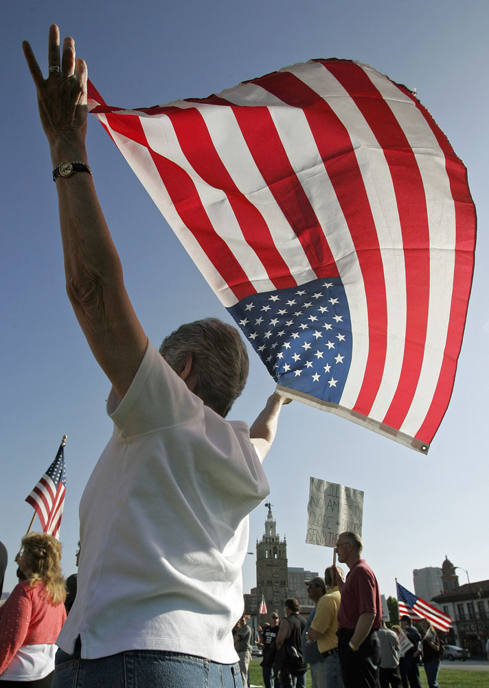 Mary Golden of brought her flag to a counter rally in favor of enforcing immigration laws.