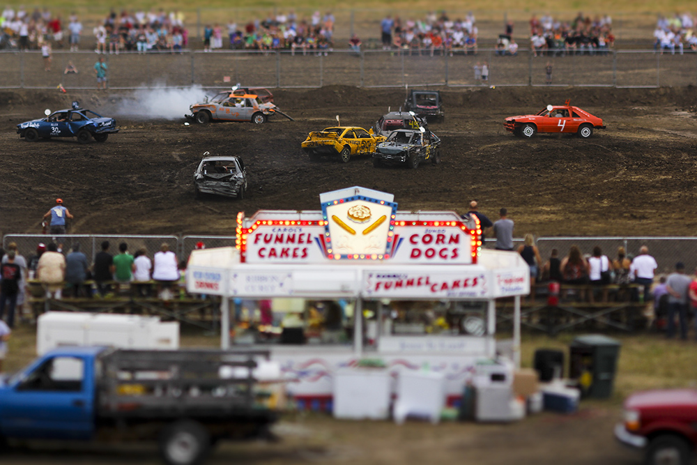 The Wyandotte County Fair hosted one night of demolition on July 29th. A driver can invest anywhere from 500 to $10,000 on a car. It's not a total loss on a junked car when if a driver can save the parts on one car and use it on another. {quote}Anybody that thinks they're making any money is probably mistaken,{quote} according to Jack Teegarden who's been derbian for nearly 30 years and isn't sure how many derby cars he presently owns.